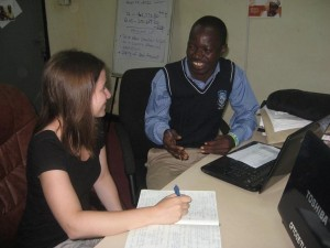 Laura with Augustine in Tamale office