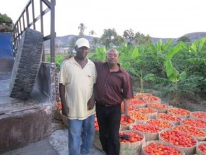 Madsen Gachette  and local farmer with tomatoes
