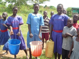 Bubuzi PS. students collect water for cooking washing