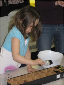girl planting indoors