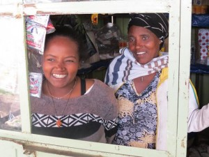 woman and daughter in market stall