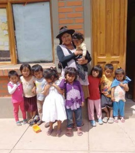 Teacher Agripina Caballero and some of the newly-sponsored children at K'acha K'acha school.