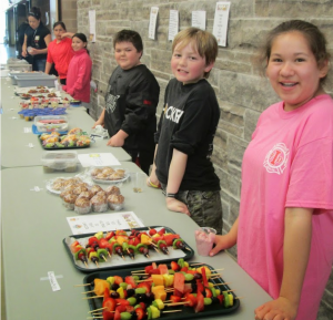 Cape Croker students proudly show off their healthy bake sale items - just one of the many fun activities that teach students about healthy eating.