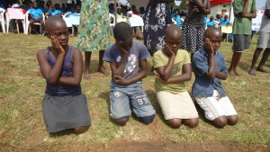 School children performing a skit at an African Day of the Child event. These are important ways to raise awareness of critical issues that affect child welfare, including early marriage.