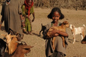 Girl carrying goat ETH