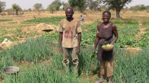 A beneficiary couple harvest vegetalbes for their home