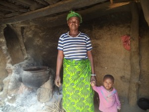 Mwinpog Dan-yi and her youngest child. She has doubled her farming yield thanks to participation in a sustainable livelihoods program running in northern Ghana.