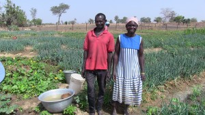 Augustina and her husband team up to cultivate vegetables.
