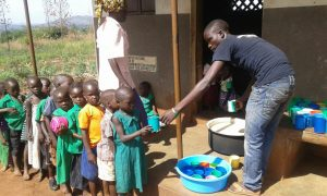 Best.Gift.Ever in Action: Faith gets a meal of porridge at school