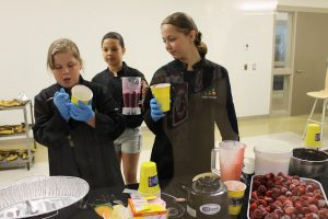 Youth Champions help make healthy smoothies for students at school events