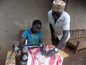 Tailor made: Ali is passing on his sewing skills to help girls avoid child marriage