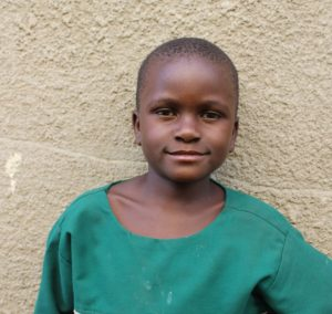 Changing lives: patience in front of her school