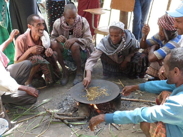Spreading the love: Men perform a coffee ceremony in Ethiopia, a role traditionally performed only by women.