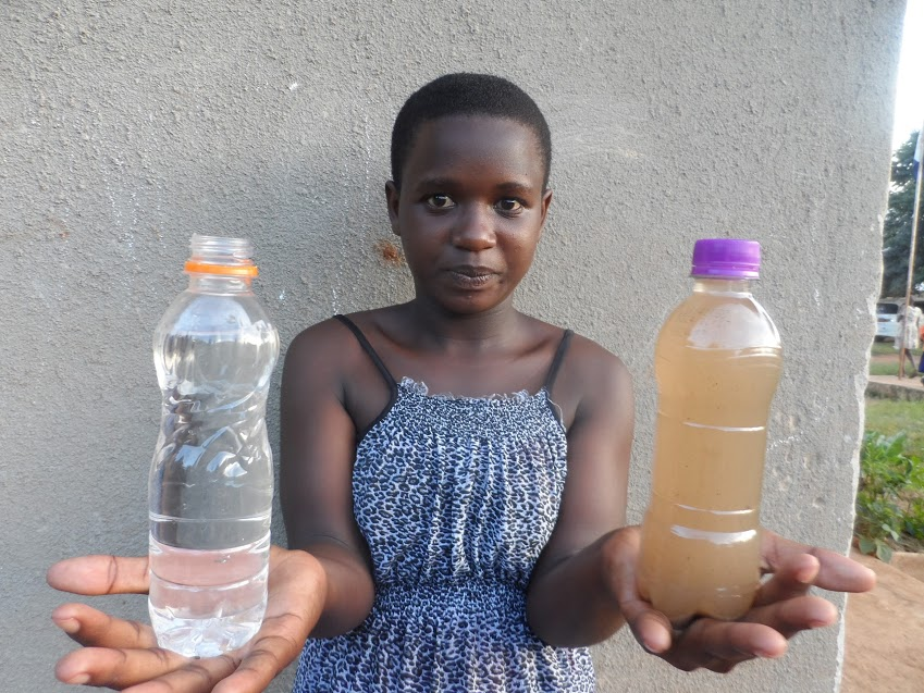 Ripple Effect: Joan holds bottles of dirty water and clean water. World Water Day 2018. Nature for Water #NatureForWater #WWD2018 #WorldWaterDay