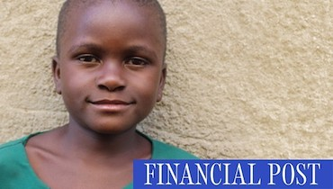 Patience, a seven-year old girl from Uganda looks straight ahead, smiling
