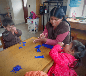 Teach with love: Andrea with children at the la barranca centre