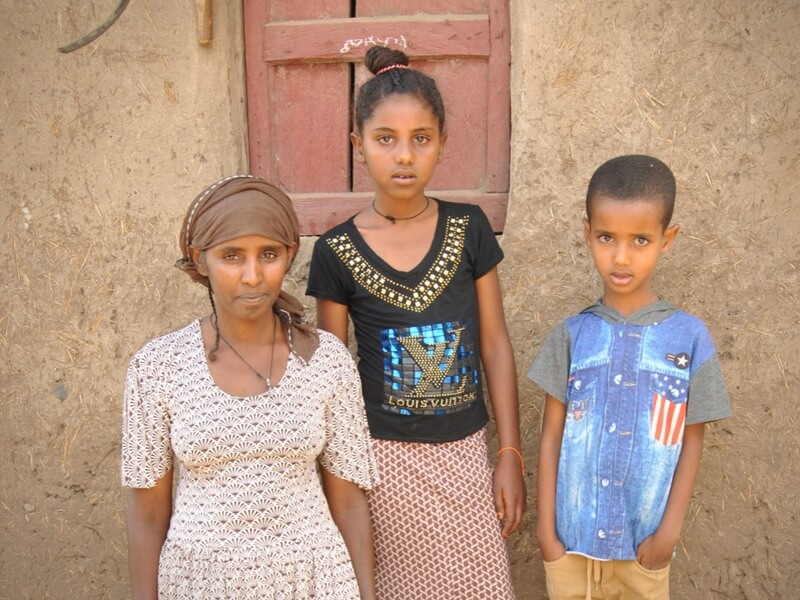 A mother's promise: Yeshi, a sheep farmer, with her two children in Ethiopia