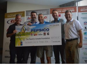 PepsiCo Canada Foundation members smiling holding a cheque for CFTC