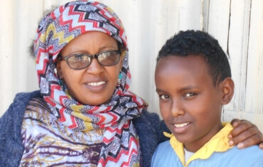 Etalemaw and her son smile for the camera