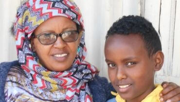 Etalemaw and her son smiling for the camera