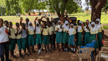 Group of smiling and waving children in Ghana