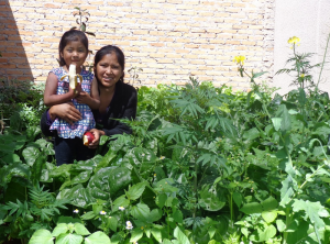 Urban gardens add fruits, veggies and income and mean less child hunger for Bolivia families like this one.