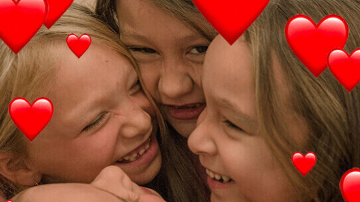 A group of girls hugging with cartoon hearts around them
