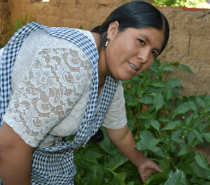 A woman shows off her garden crops
