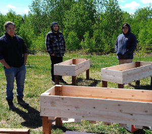 Community members building and constructing planter boxes