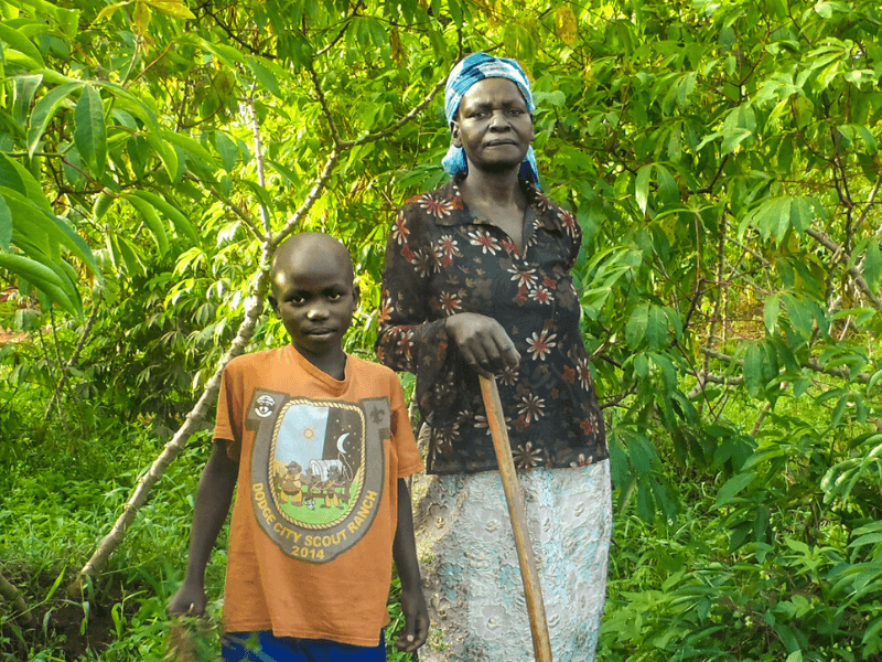 A woman and her grandson pose in their family farm