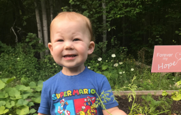 a toddler boy smiling for the camera