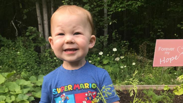 a toddler boy smiles for the camera