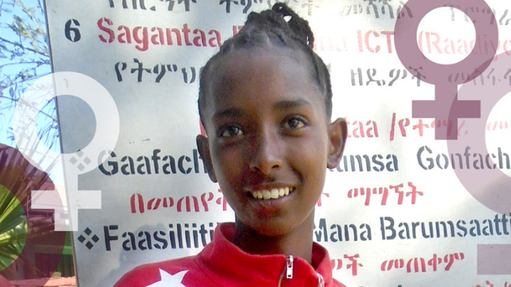 a girl smiles for the camera with cartoon female symbols behind her