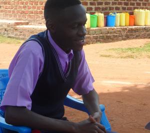 teenage boy sitting in a lawn chair outside