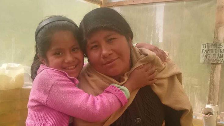 a little girl hugs her mom