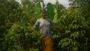Berhane stands in her coffee farm